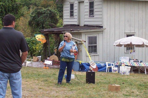 Sue Schmidt speaking at an event on the Ayres/Knuth Farm