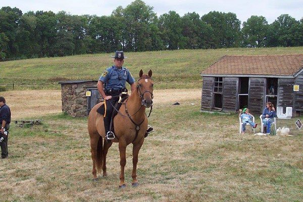 Policeman on a horse at the Ayres/Knuth Farm